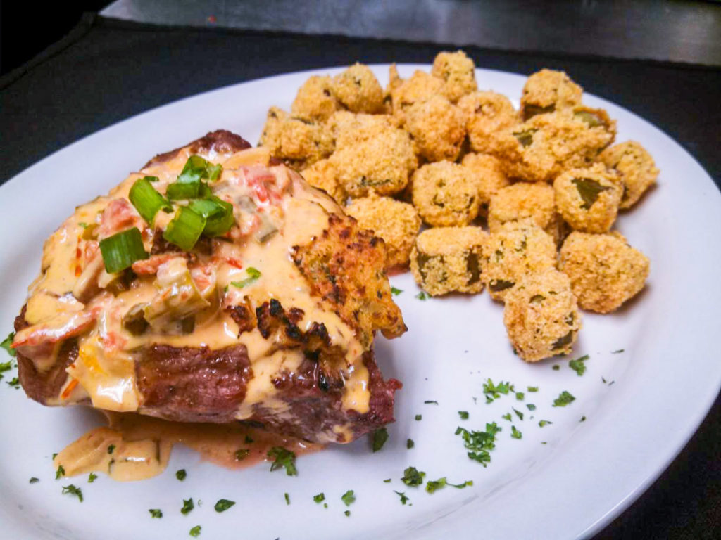 crawfish stuffed fillet topped with cream sauce and served with cornmeal fried okra